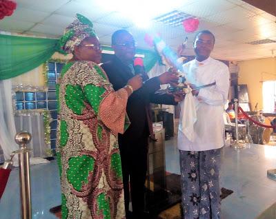 Rtd. ACG Eporwei Charle Edike(Right) receiving his Award from the Nigeria Customs Christian Fellowship at the Customs Training School Ikeja, Lagos